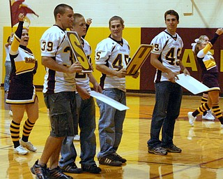 Senior Football Players, Charlie Lengyel, Ryan Rach, Craig Jones, and Jon Guy help out with the signs at a pep rally.  They are definitely better on the playing field!!