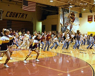"""South Range Band and Cheerleaders take the gym floor during a pep rally rocking out to Michael Jackson's """"Thriller."""""""