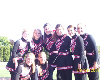 Canfield JV Cheerleading Squad take a moment for a quick picture before cheering on their team for a win against Struthers.  Kneeling left to right: Jaclyn Miller, Tessa Graham.  Back row left to right: Alyssa McCormick, Breann Machingo, Maggie Wagner, Gabby Schiraldi, Liz Cerimele and Morgan Baker.