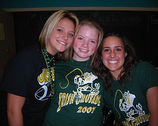 """here is the picture for the caption: Ursuline Students, Birrtaney Bertko, Kayla Spear and Lauren Chance show their irish spirit during """"Mooney Week""""."""