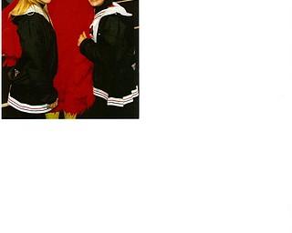 "Canfield varsity cheerleaders Jen Bruno and Adrianna Ciotola with ""The Cardinal"" Tom Porter."