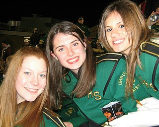Here is a picture of Ursuline High School Band students:  Erin Bouquet, Jennifer Stevens, and Annie Cadel at the Ursuline playoff win against St Peter Chanel on Friday at Stambaugh Stadium.
