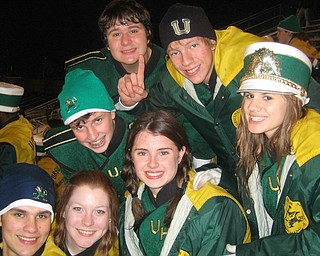 Here is a picture of Ursuline High School Band students:  (Top Row L to R) : Jimmy Hungerford, Dan Catello, Marshall Finelli  (Bottom Row L to R) :  Evan Sander, Erin Bouquet, Jen Stevens, and Annie Cadel at the Ursuline playoff win against Apple Creek Waynedale on Friday at Canton Central Catholic Stadium.  .