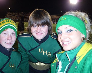 Cheerleader Katie Olenick poses with two students from the band, William Wanio and Jonathan Tomko