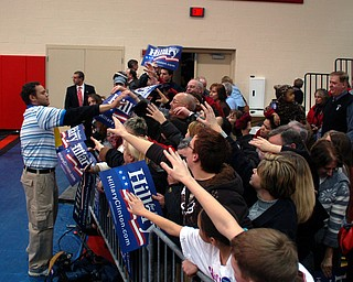 Handing out posters to the crowd at Chaney for Tuesday's Clinton rally