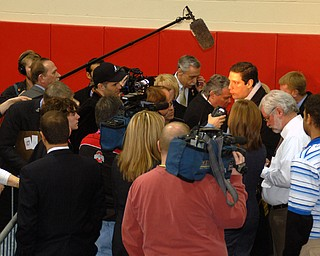 U.S. Rep. Tim Ryan of Niles gets confronted by the media immediately upon entering Tuesday's rally for Clinton at Chaney High School
