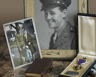 Memorabilia, including the Purple Heart Thomas Gent was awarded.