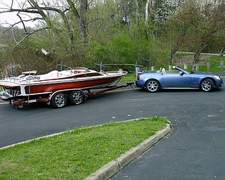 William E. Maine of Boardman loves his customized Cadillac and 21-foot Cheyenne Day Cruiser.
