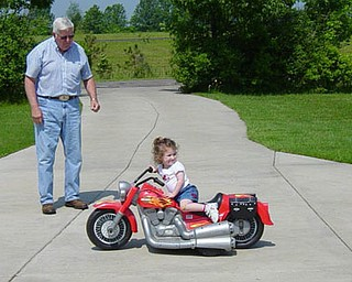 """Jill Moran's daughter, Madelyn, 3, takes charge of her """"motorcycle."""""""