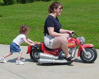 Jill Moran's daughter, Madelyn, 3, gives mom a push.