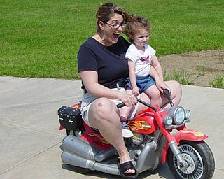 Jill Moran's daughter, Madelyn, 3, enjoys a ride with mom.