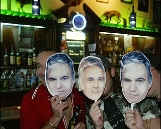 Royal Oaks Tavern patrons with cutouts  of Jim Traficant, the former congressman, currently in jail, during a birthday party Thursday.