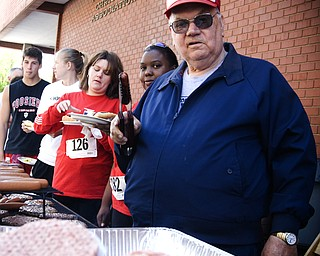 Grill master and YMCA volunteer Van Bates of Youngstown offers up another hot dog -- a gesture Jason Schilling had become all too familiar with.