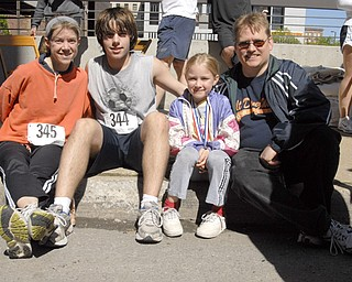 L-R: Linda Rein, Dan Rein, Katie Rein and Karl Rein of Austintown. According to Linda, Katie, who has not yet turned 12, is the family's most sought after and experienced runner. Linda said Katie got local media attention after breezing through the Smokey Hallow race at age 3.