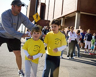 Elizabeth Galla, 6, and her sister Lillian, 4, of Poland needed a gentle push from their father, Bill, to start running.
