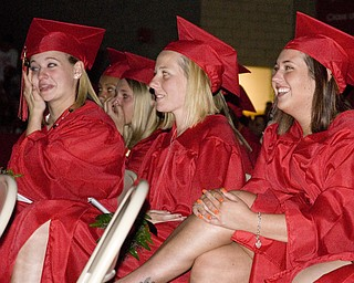 Diplomas were followed by a slide show made of snaps-shots from graduates' family photo albums. Melissa Eggleston, left, cried. Jessica Ferrick, right, laughed. In the center, Candice Fair, remained calm.