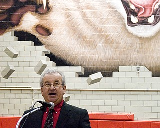 Struthers Superintendent Don Daily helped open commencement with a speech centered around the word 'red,' and the impact of a Struthers education. He ended by wishing graduates inspiRED, incREDible futures. The 'impact' portion of his speech was underlined by the giant cat smashing through the brick wall behind him.
