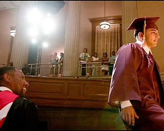 6.1.2008 Thair Mahmud Farah walks up to the stage to receive his diploma during Liberty High School's commencement at Stambaugh Auditorium Sunday afternoon.