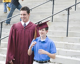 Say Cheese: Graduate Daniel McCarthy and Younger brother Michael clown for the camera. Stambaugh auditorium was packed with over a hundred graduates and their families.