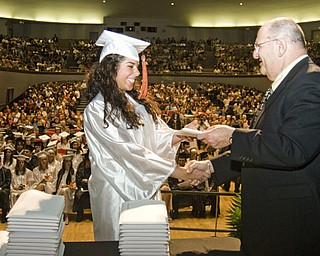 Alyssa Ruberto accepts her diploma from board of education member Scott Lehman.