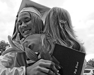 Kim Bertmeyer embraces her sister after the ceremony.