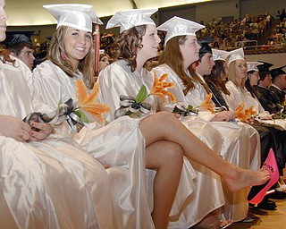 Natalie Alberini didn't want to wear out her shoes before walking across the stage.