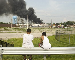 Youngstown residents Sheldon Johnson, 11, and Leon Bell, 9, watch the fire from over a mile away.