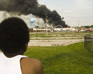 More than a mile away, Leon Bell, 10, of Youngstown watches the building's incineration.