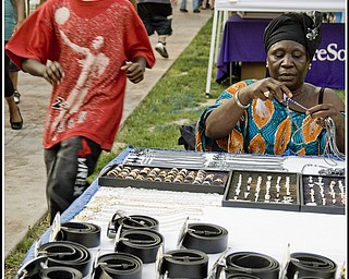 Awa Thian came from Senegal by way of Cincinnati. She sold belts and necklaces at the festival.