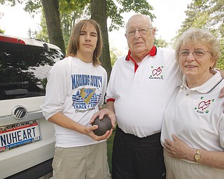 TRANSPLANT GAME PARTICIPANT: Russell D. Beatty Sr., center, who has a new heart, will be in Pittsburgh this weekend to compete in the U.S. Transplant Games, an Olympic-style event for people with organ transplants. With him is his wife Ruth, and his grandson, Travis Beatty, who trains his grandfather in the shot put.