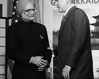 US President George W. Bush, right, with Prime Minister of India Manmohan Singh, left, following their meeting at the G8 summit, Wednesday, July 9, 2008 in the lakeside resort of Toyako on Japan's northen island of Hokkaido.