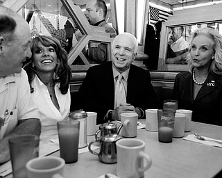 Republican presidential candidate Sen. John McCain, R-Ariz., and his wife Cindy, are joined by Lydia Gutieriez. second from left, and others, during a campaign stop at Senate Coney Island Restaurant in Livonia, Mich., Thursday, July 10, 2008.