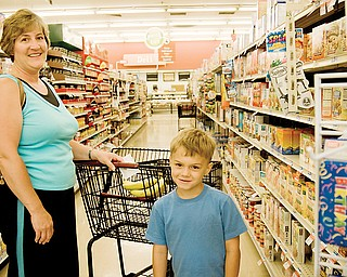 "Lori Filicky and her son Mark, 5, of Boardman shopping at the Giant Eagle in Cornersburg. ""I'll certainly miss it,"" She said, ""With three boys, I've been here nearly everyday for 17 years."""