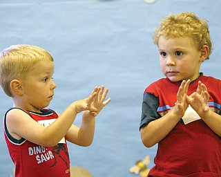Michael Gensamer, 3, of Ellsworth, left. and Matthew Vitelli, 4,  of Austintonwn make butterfly motions during  a Friday 7-11 program on butterflies at the Ford Nature Center in Mill Creek Park.