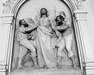One of the reliefs - station of the cross along the walls at Mt Carmel -  100th anniversary of Our Lady of Mount Carmel Church.
