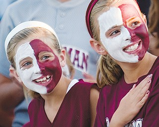 [7.15.2008] Colleen Durkin (left) Taylor Martin (right), both 9 years-old and from Boardman, listen to the playing of the national anthem before the game against visiting Canfield, at Mccune Field Tuesday night.