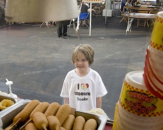 The view from inside the Denny's Charbroiled Steaks concession at the Italian Festival at Mt. Carmel Church in Youngstown, OH. Thursday, July, 24, 2008. Rebecca MacDonald, 6, wonders about a corndog. Daniel C. Britt.