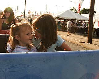 Lazazzera sisters Annika, 6, and Mia, 1 1/2, of Canfield, ride the train at the Italian Festival at the Mt. Carmel Church in Youngstown, OH. Thursday, July, 24, 2008. Daniel C. Britt.