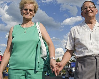 Dating: Rina Cavano of Poland and Ed Chermansky of Youngstown hold hands at the Italian Festival at Mt. Carmel Church in Youngstown, OH. Thursday, July, 24, 2008. Daniel C. Britt.