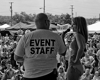 A contestant answers questions during a segment of the bikini contest at the Jeep Festival at the Canfield Fair Grounds on Sunday, July 27, 2008. Daniel C. Britt.
