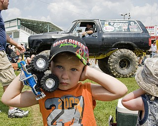 Sylas Reiheld, 3, of Stow, covers his ears when the trucks around him start revving their engines at the Jeep Festival held at the Canfield Fair Grounds on Sunday, July 27, 2008. Daniel C. Britt.
