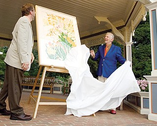"7.25.2008 Keith Kaiser, Horticulture Director of Mill Creek Metro Parks, and artist, Gary Bukovnic, reveal his work, ""Golden Celebration,"" a painting of the parks spring bulb display during a dinner party at Fellows Riverside Gardens Friday evening. Geoffrey Hauschild"