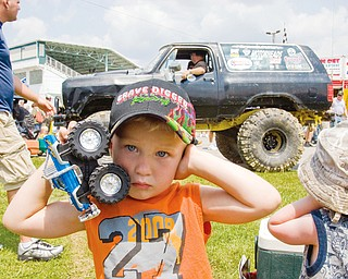 Sylas Reiheld, 3, of Stow, covers his ears, to blot out the revving truck behind him at the Jeep Festival at the Canfield Fair Grounds on Sunday, July 27, 2008. Daniel C. Britt.