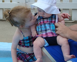 "Photo taken at Poland Swim Club on July 6, 2008 . ""Sydney loves her new litte sister!"" Sydney Henderson, 3, and 