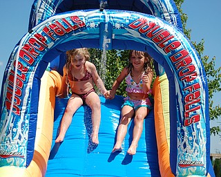 This is a picture of best friends Sophia Yurich, 4 years old  and Connie Cougras, 5 years old sliding down their outdoor waterslide together.  Picture by mom, Kim Yurich of Poland.