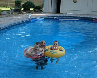 I took this picture of our grandchildren Logan and Abby with my husband Frank in our backyard pool.
