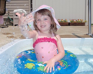 Hensley Nicholson, 2  1/2 years old, splashing around the pool.  The picture was taken by her Aunt Denise.