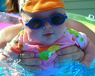 This is a photo of Madeleine Devlin, at 3 months old, who loves playing in the pool.