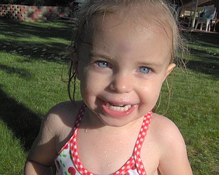 Elizabeth Nadzam, 2,  daughter of Nolan and Maria Nadzam of Boardman, enjoying the sprinkler on a hot summer day!