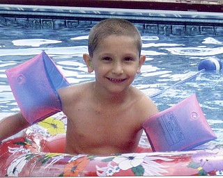 Nick Geraci, 6, enjoys time in grandparents' pool. Son of Tony and Kerry Geraci of Boardman. (Goes with pic of him at 3 months in same pool.)